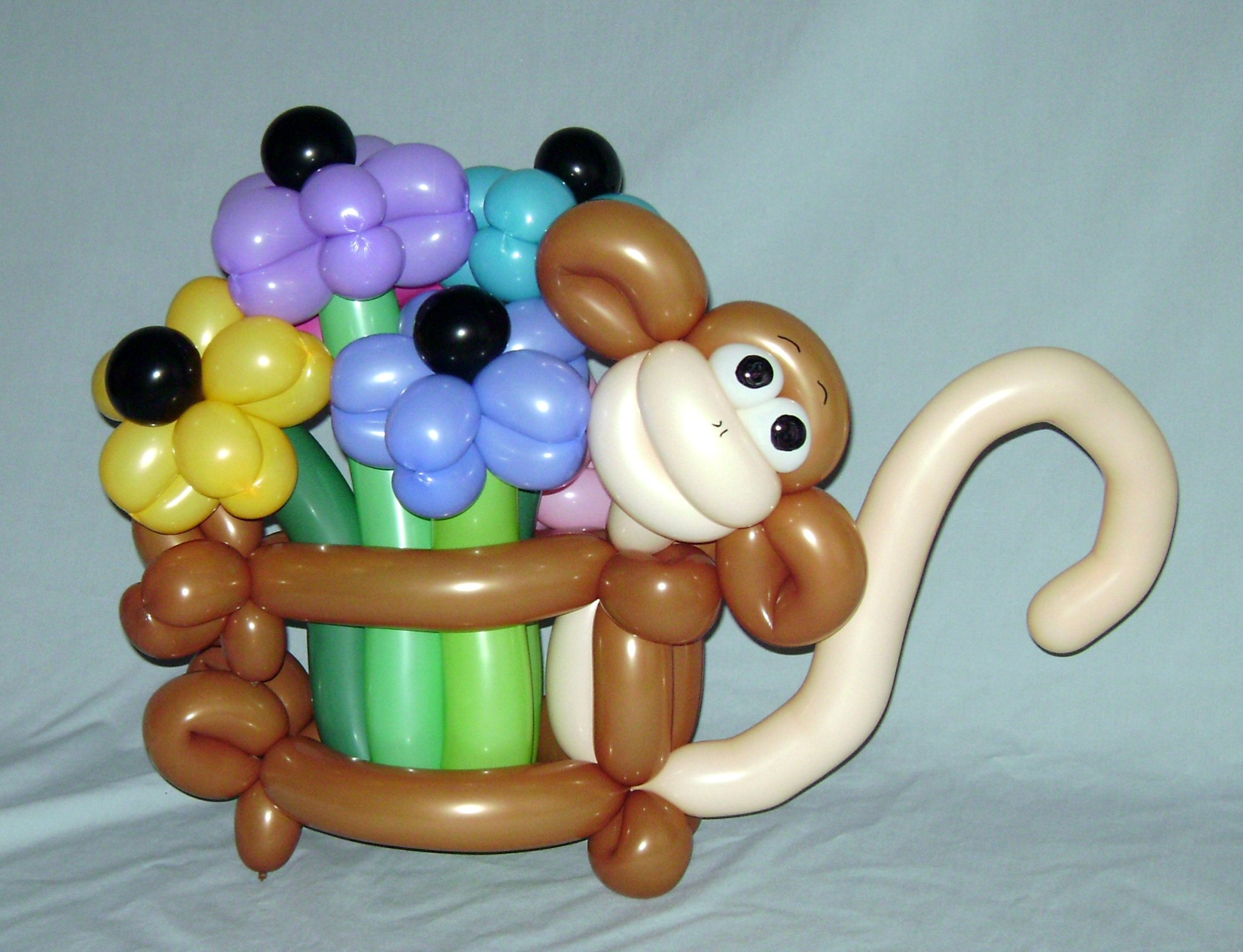 SAMMY J Balloon Creations st louis balloons monkey flowers