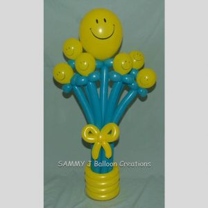 smiley face balloon bouquet by SAMMY J Balloon Creations
