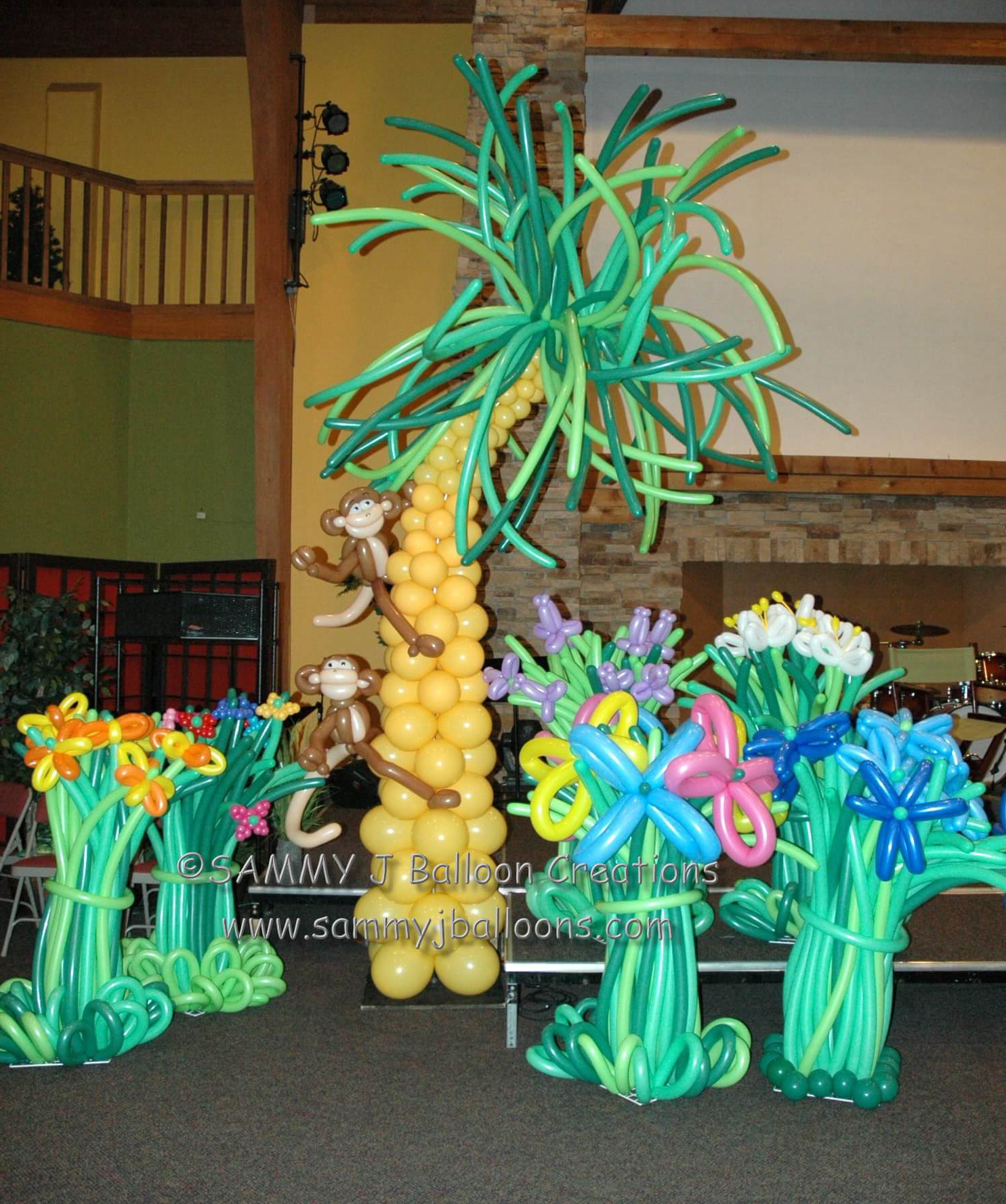 SAMMY J Balloon Creations st louis balloons monkey palm tree flowers